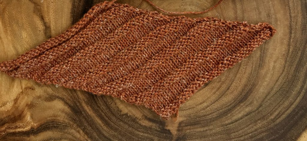 nua worsted biased swatch in harvest moon colour.