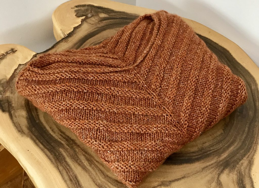 rusty Lines sweater folded up