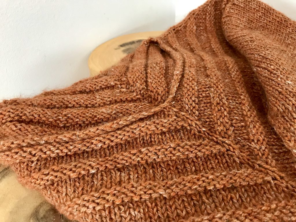 neck details of rusty lines sweater