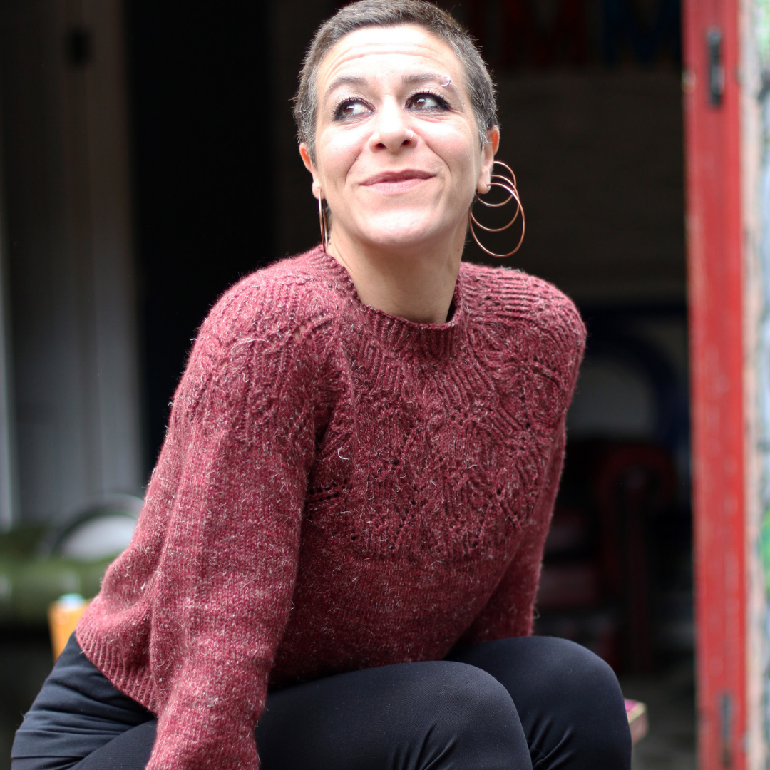 woman wearing red sweater called comerford from cosy knits