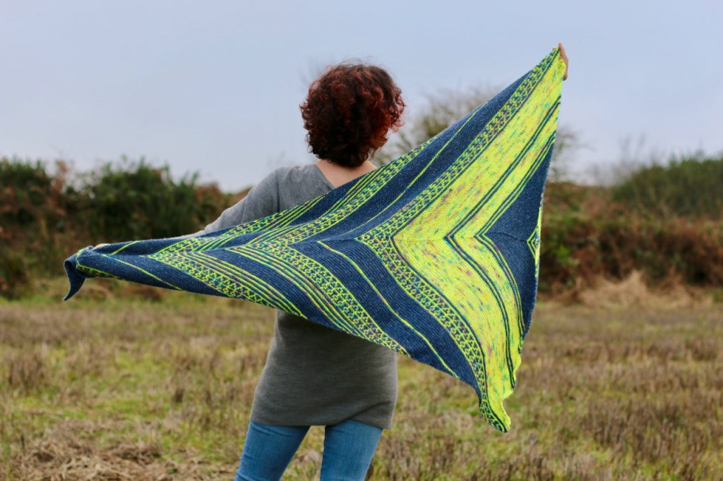 neon skyline shawl shown from back in neon yellow and navy yarn, townhouse yarns and stolen stitches nua