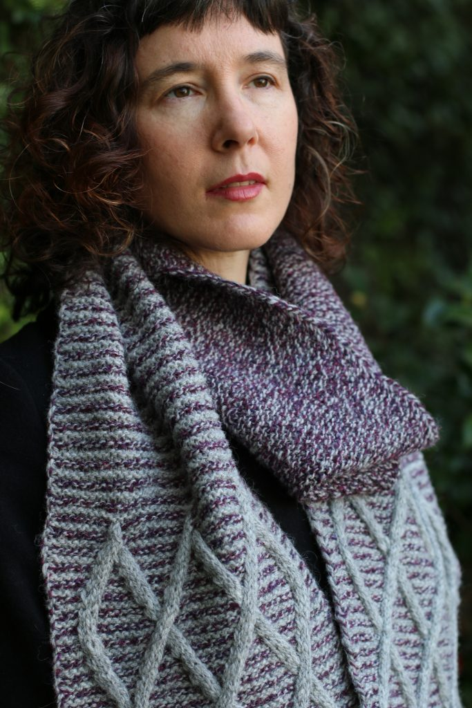woman wearing cabled scarf in two colours