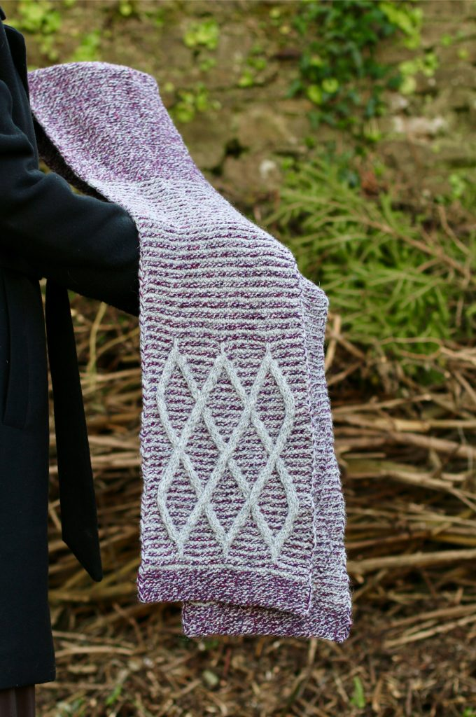 detail of the scarf stretched out with cable detail showing