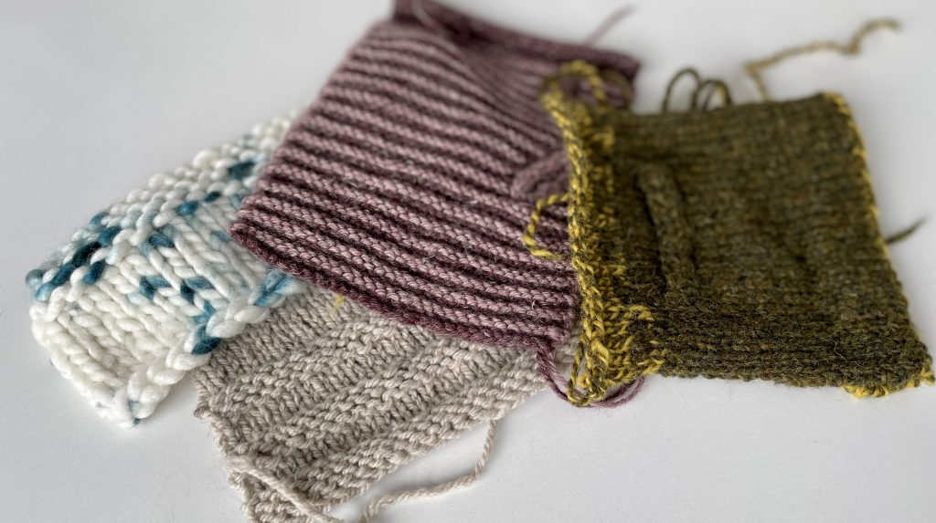 pile of knitting swatches