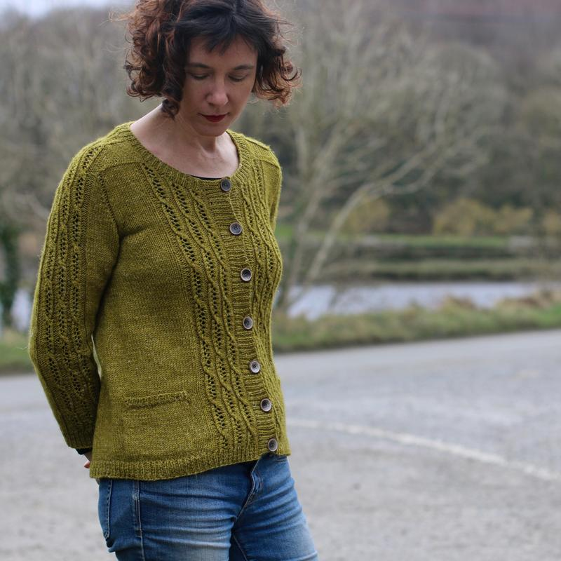 An autumnal yellow cardigan called Tabouli pictured infront of a Irish lake